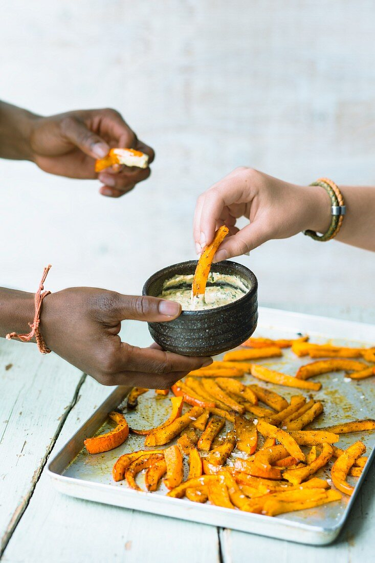 Oven-baked pumpkin fries with Chermoula mayonnaise