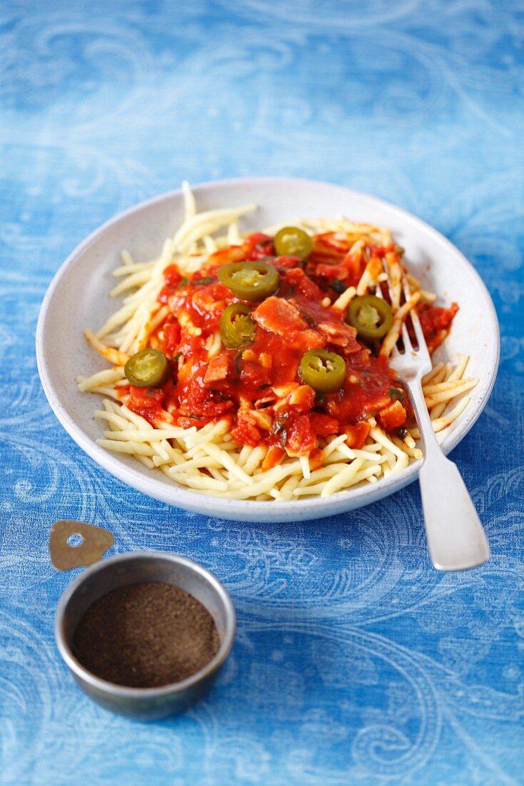 Trofie pasta with amatriciana sauce and jalapeños