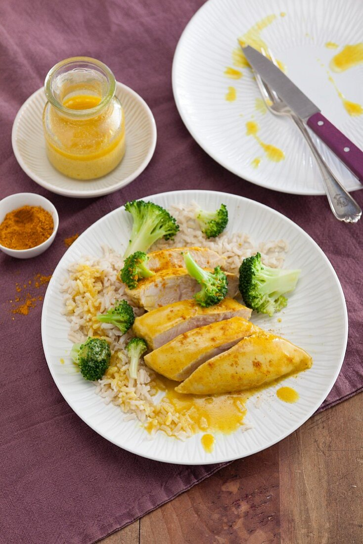 Roasted turkey steaks in a curry yoghurt marinade with wholegrain rice