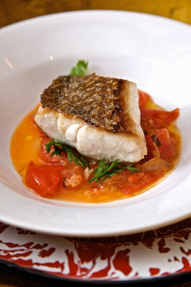 Seared seabass with tomatoes and sage