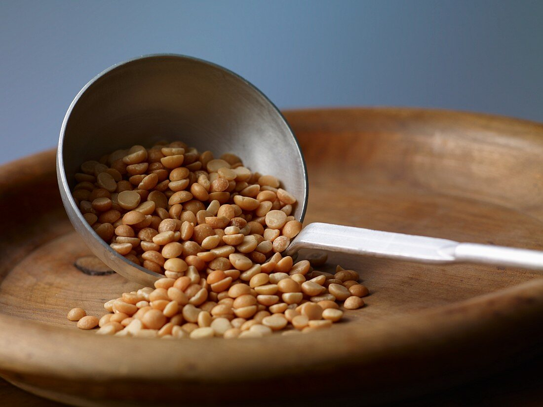 Yellow split peas on a ladle
