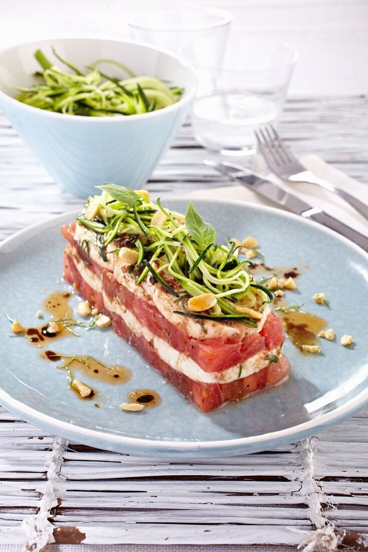 Red and white vegetable terrine with mozzarella, courgette pasta and basil
