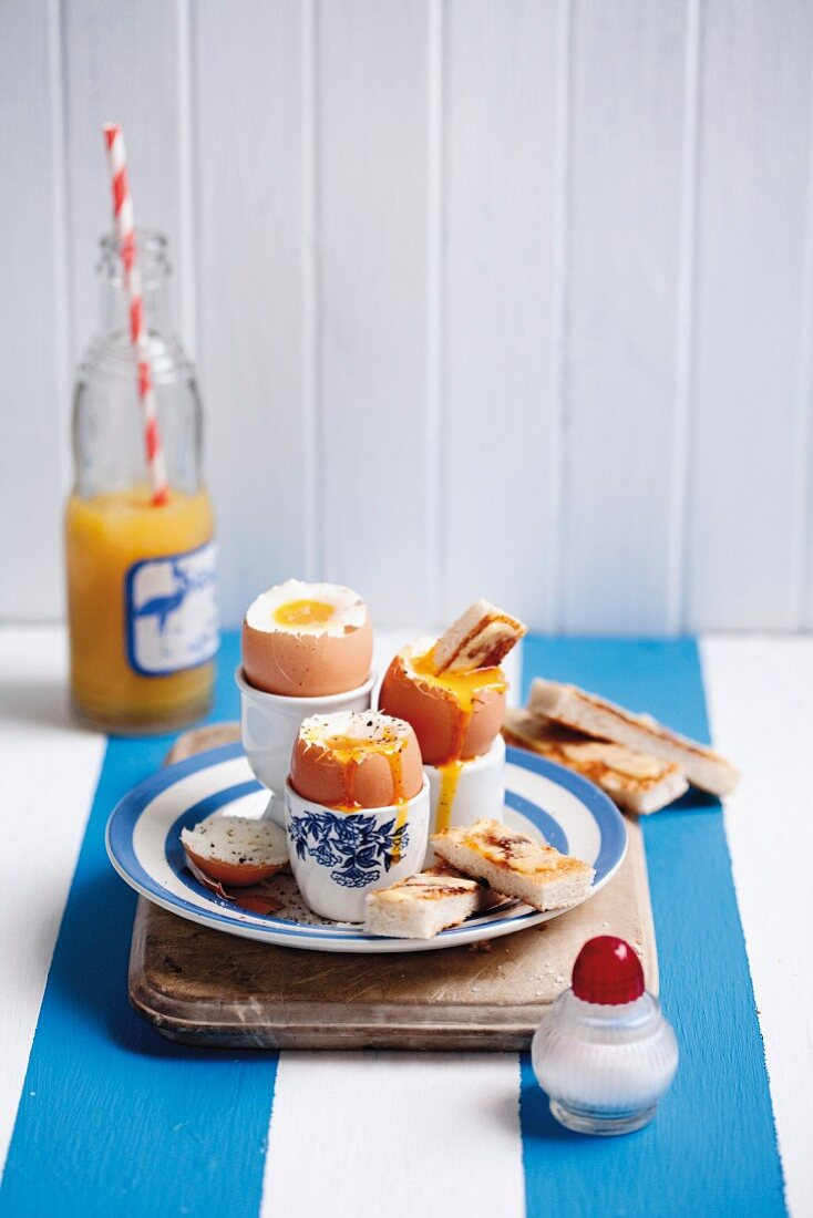 Soft-boiled eggs served with toast soldiers and anchovy butter