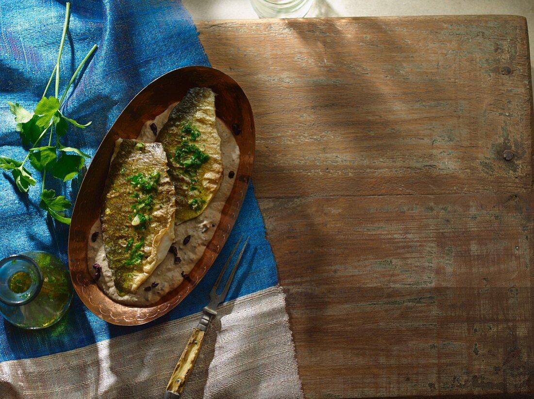 Seabream fillets on aubergine cream
