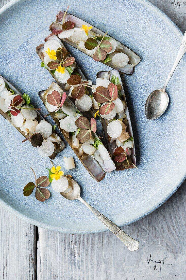 Razor clams with radish and edible flowers