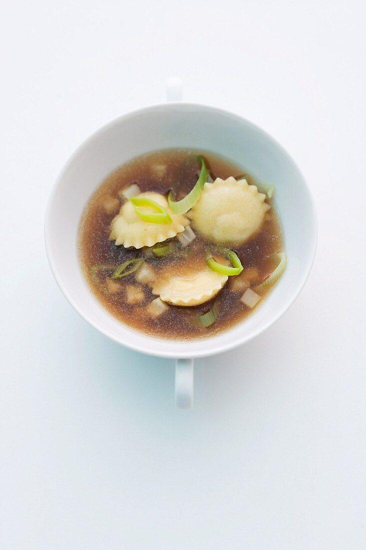 Duck broth with truffle and onion ravioli