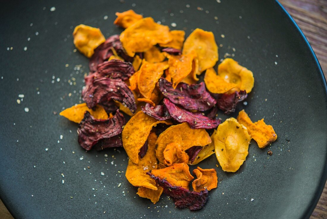 Colourful vegetable crisps (carrots, parsnips and beetroot) with salt