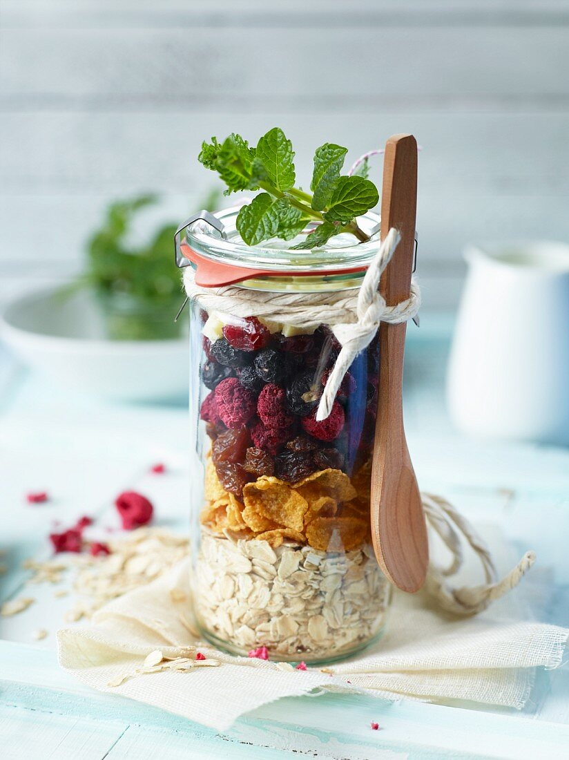 Ingredients for berry muesli in a jar as a gift