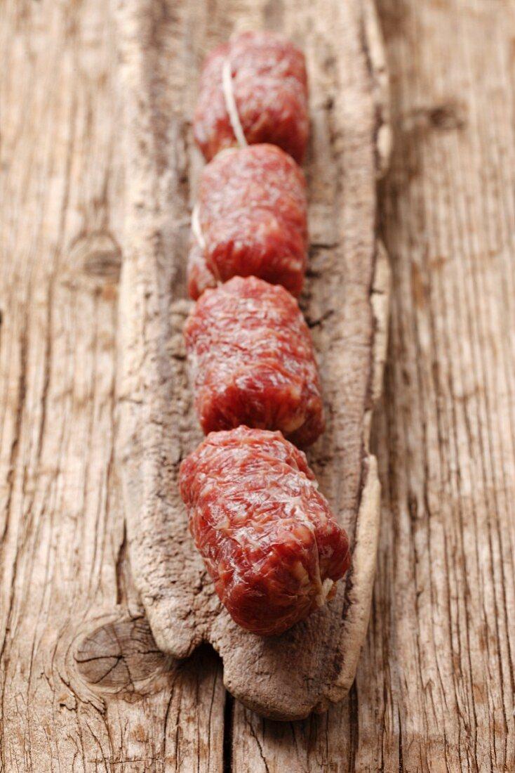 Italian salami on a wooden surface