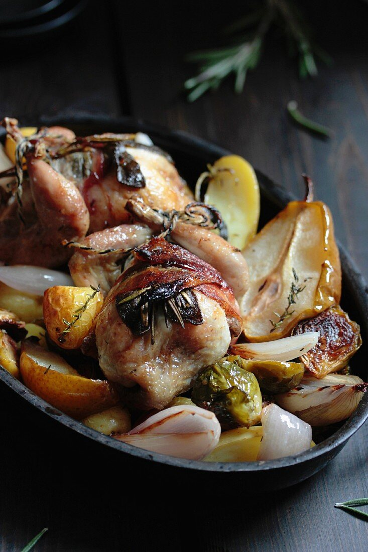 Fried quails with pears, Brussels sprouts and potatoes