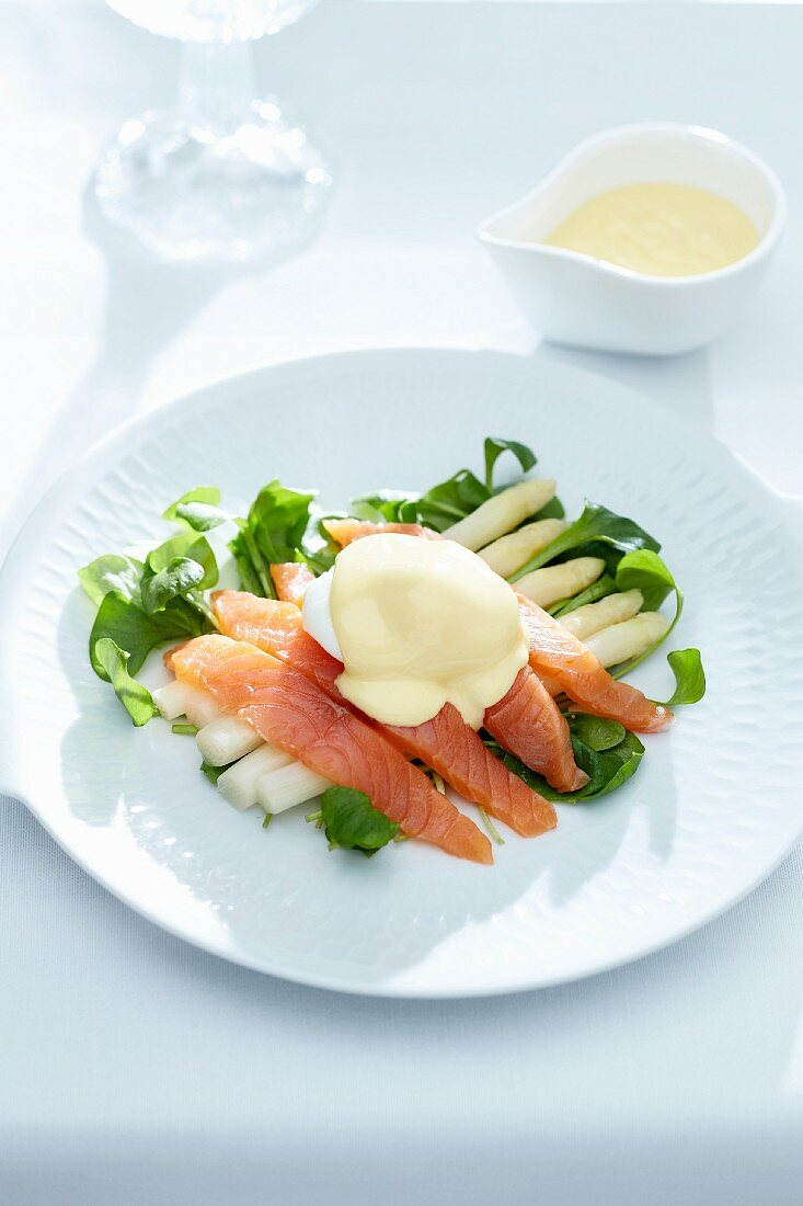 White asparagus with salmon, poached egg and Hollandaise sauce