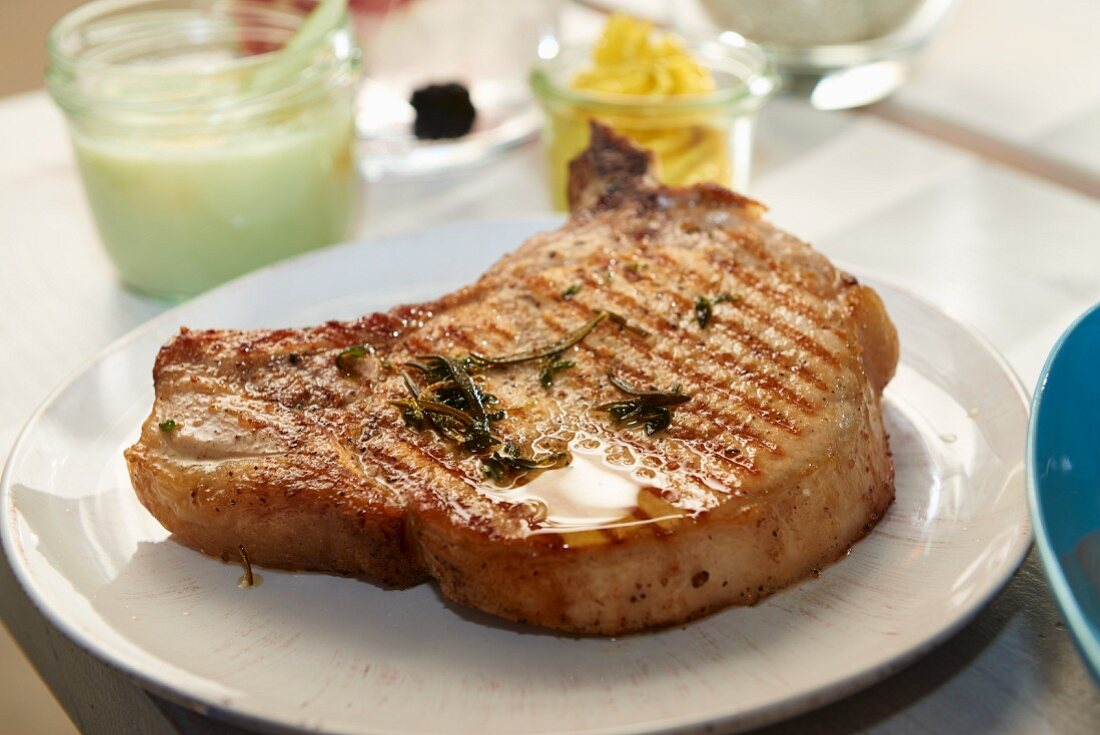 An organic pork chop with curry butter