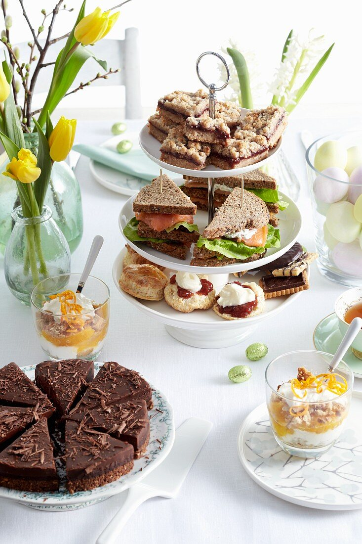 An Easter buffet with cake, biscuits and sandwiches