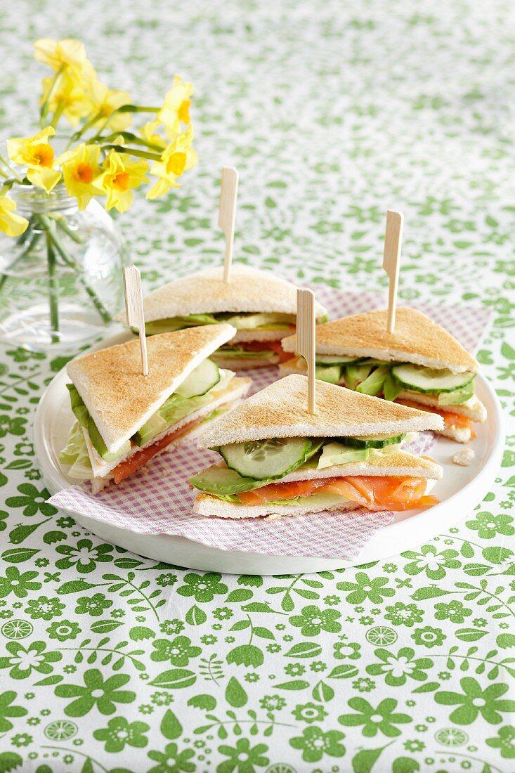Club sandwiches on a white tray