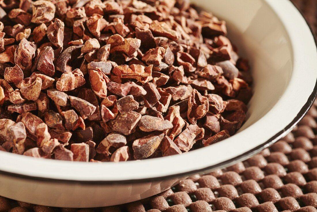 Cocoa nibs in enamel bowl