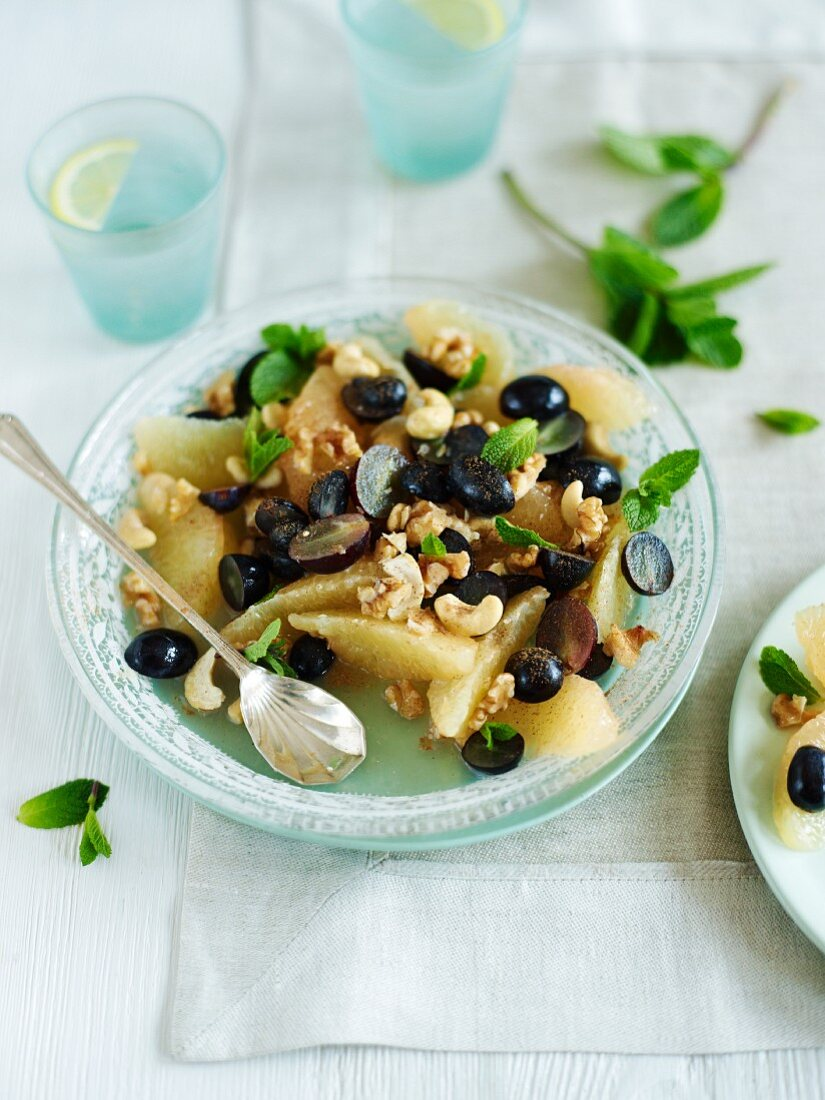 Grapefruit and grape salad with nuts and mint