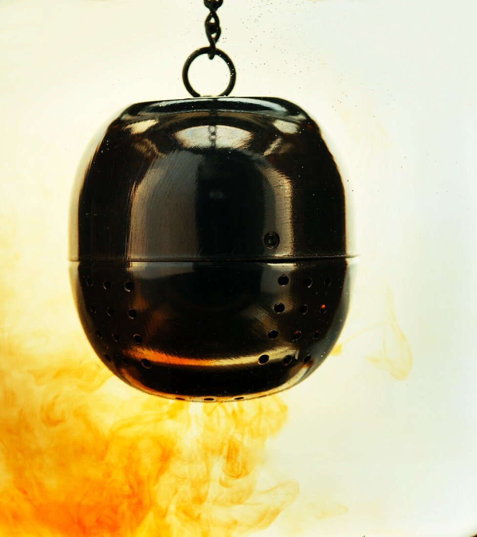 A tea egg brewing in hot water (close-up)