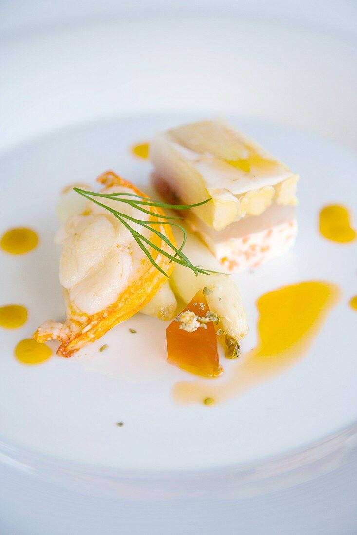 Langoustine medallions with asparagus terrine and strawberry and pepper jelly