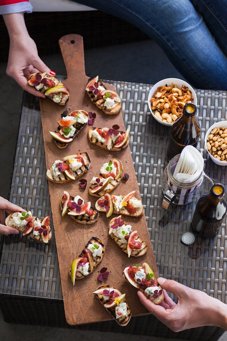 Crostini with blue cheese and figs and a variety of seasoned nuts