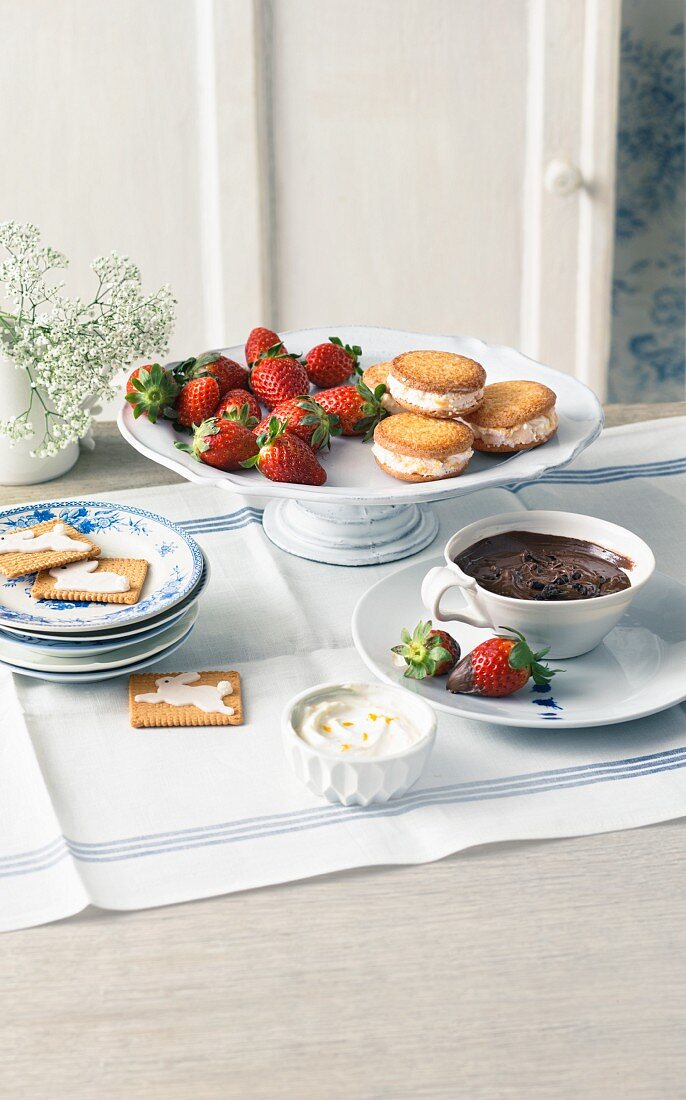 Ice cream sandwiches and chocolate fondue with strawberries as an Easter dessert
