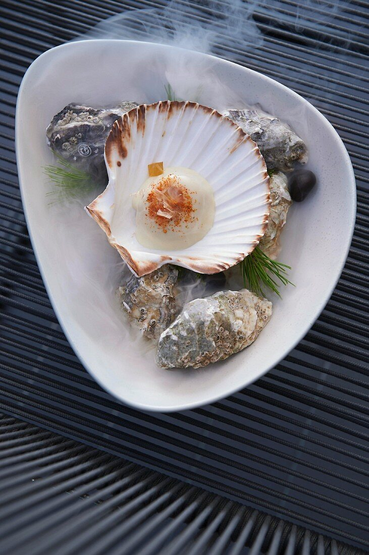 A scallop with ginger gel, dashi jelly and bonito flakes