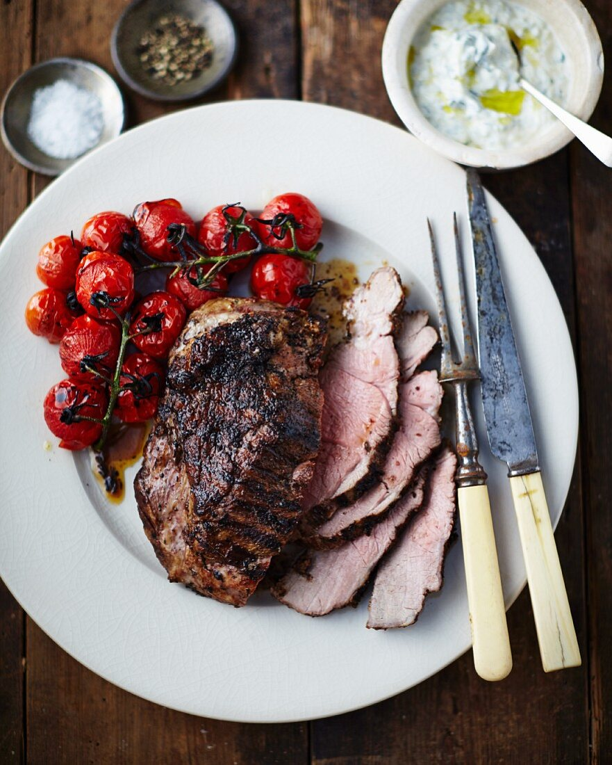 Roast beef with cherry tomatoes and mint and garlic yoghurt