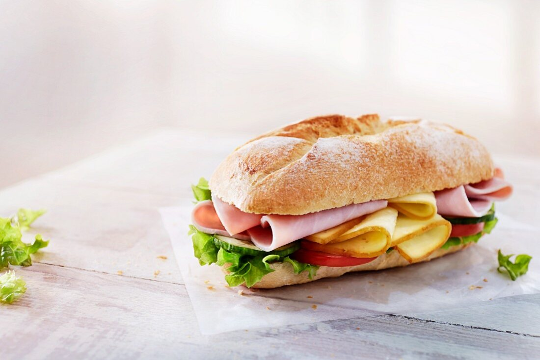 Baguette with ham, cheese, vegetables and lettuce