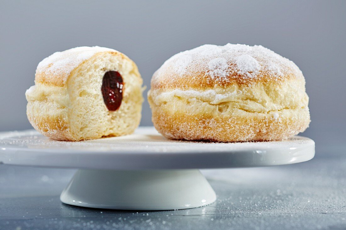 Doughnuts with icing sugar and ham, whole and halved