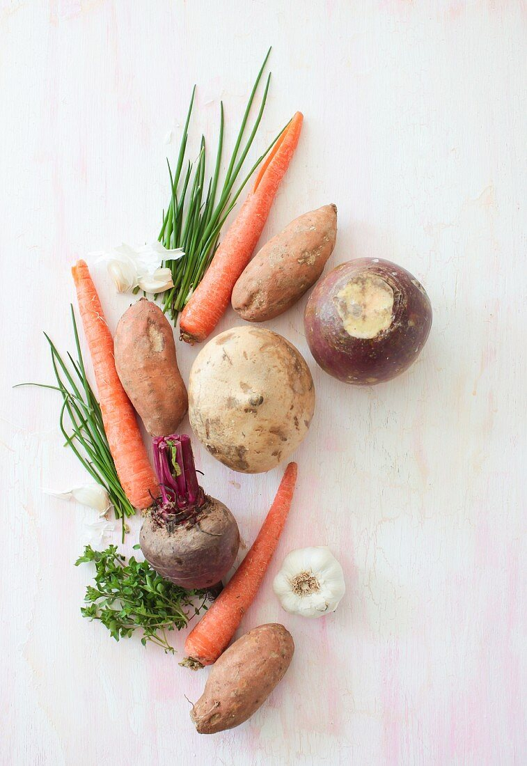 Various root vegetables, garlic and herbs