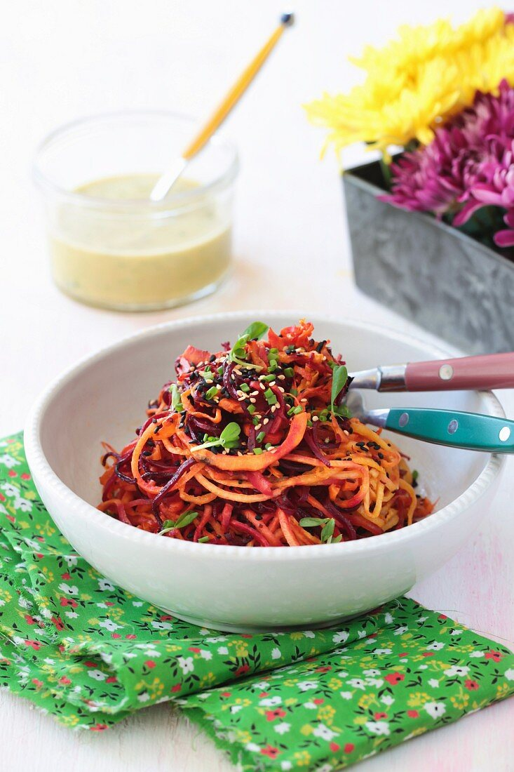 Roasted root vegetable spiral salad with a citrus dressing