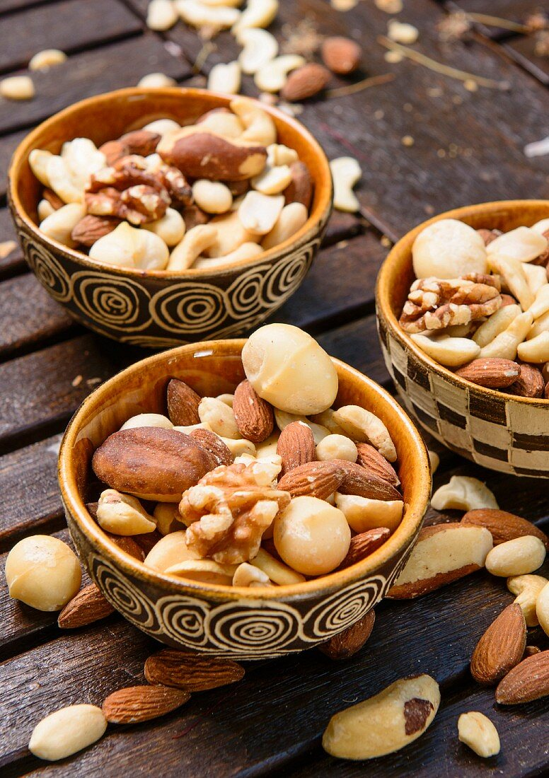 A table laid for Christmas in a garden with elegant African decorations and bowls of nuts