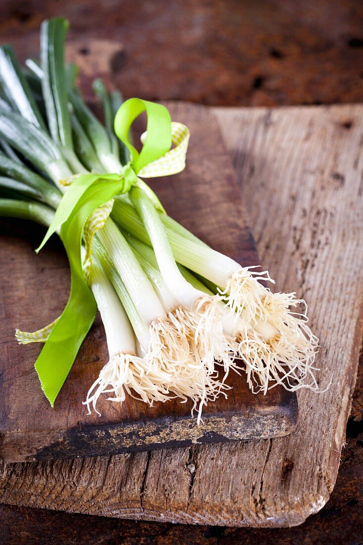 Spring onions tied with a green satin ribbon