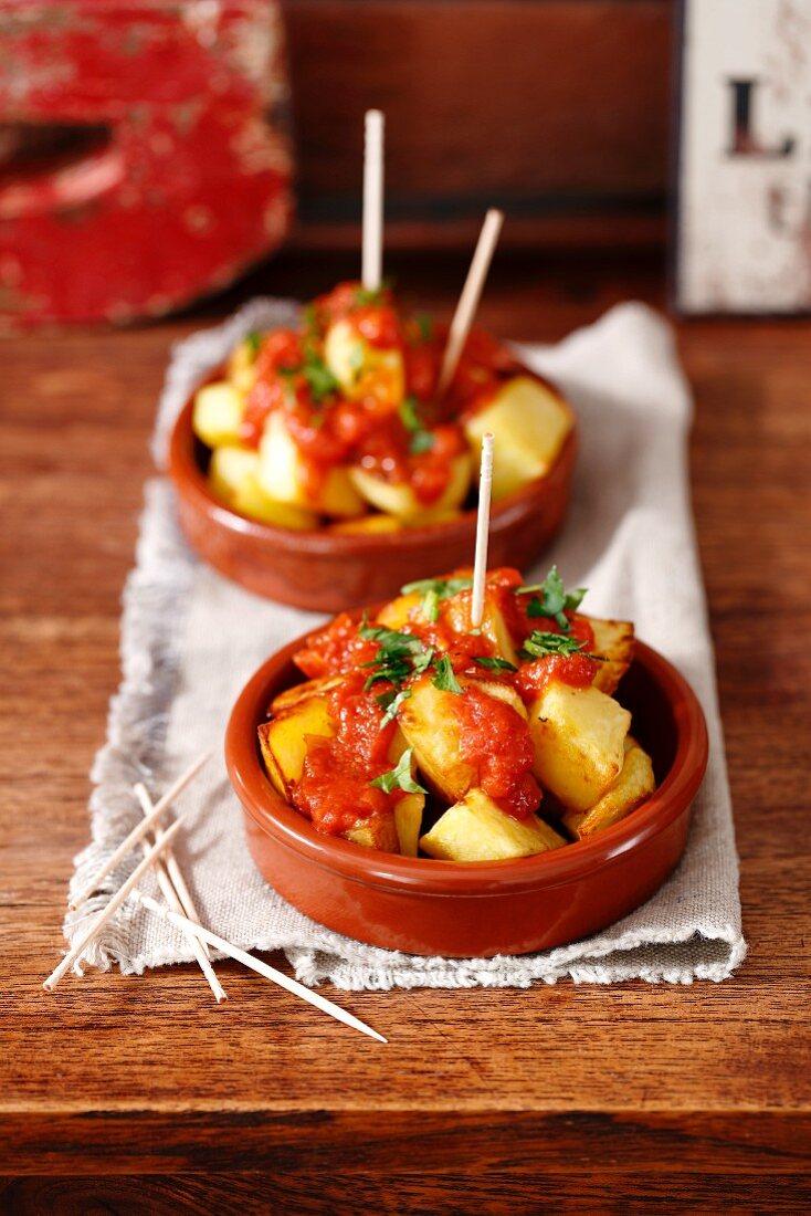 Patatas bravas (baked potatoes with tomato salsa, Spain)