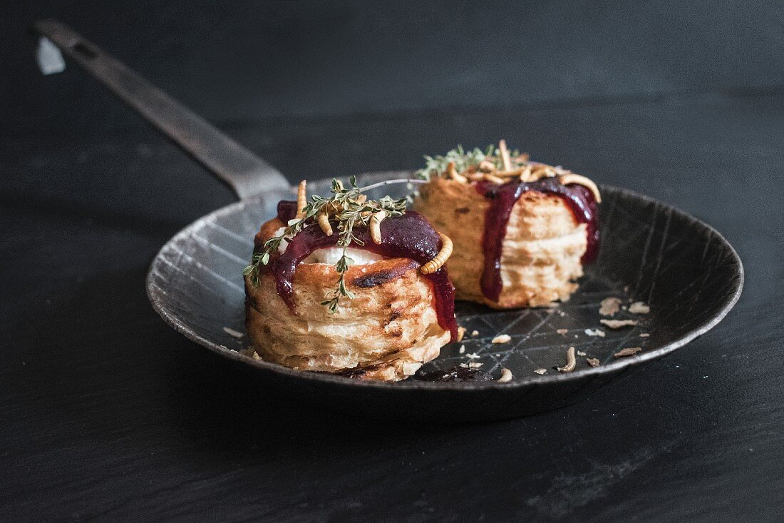 Goat's cheese vol-au-vents with lingonberries and crispy meal worms
