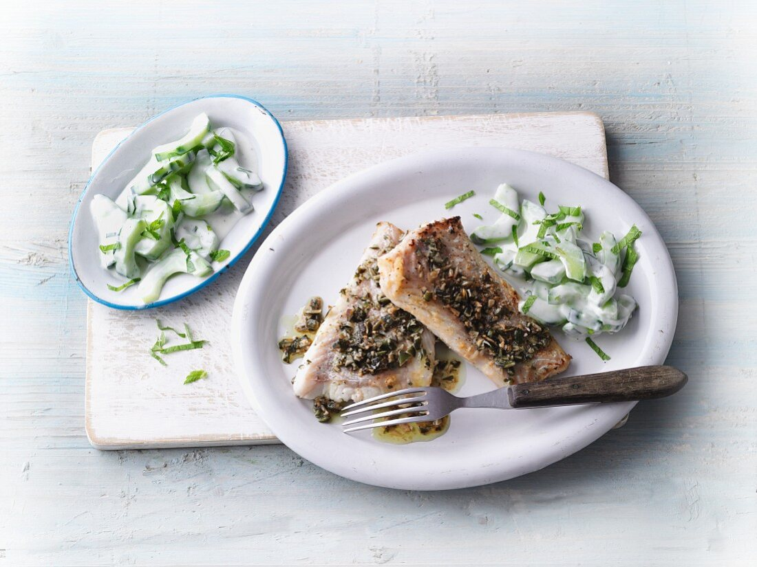 Fish in a pumpkin seed coating with a cucumber salad
