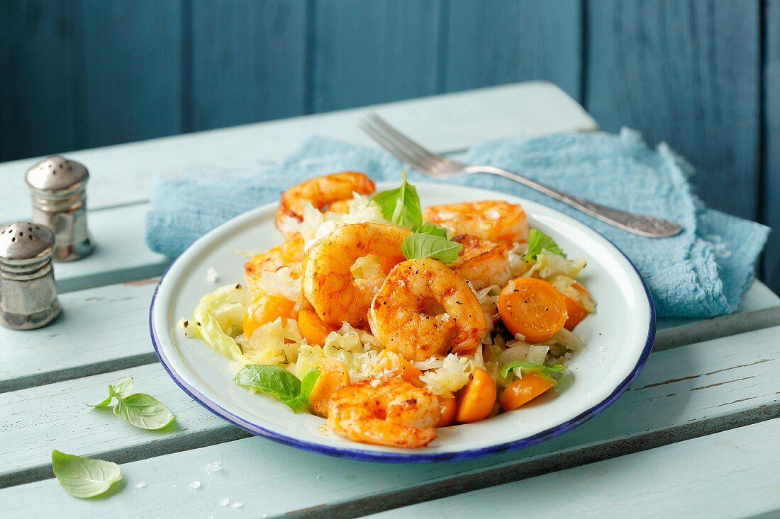 Curried prawns on a pointed cabbage medley with physalis (simple glyx)