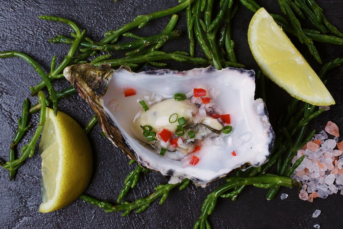 Marinated oyster with lemons and seaweed