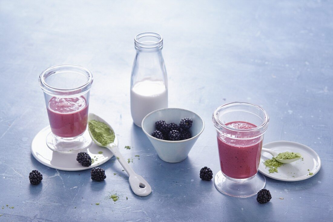 Banana and blackberry smoothies with barley grass powder and almond milk