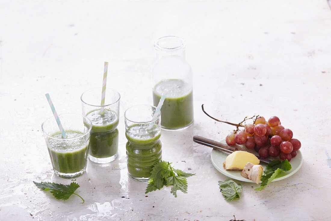 Stinging nettle and spinach smoothies with grapes and ginger