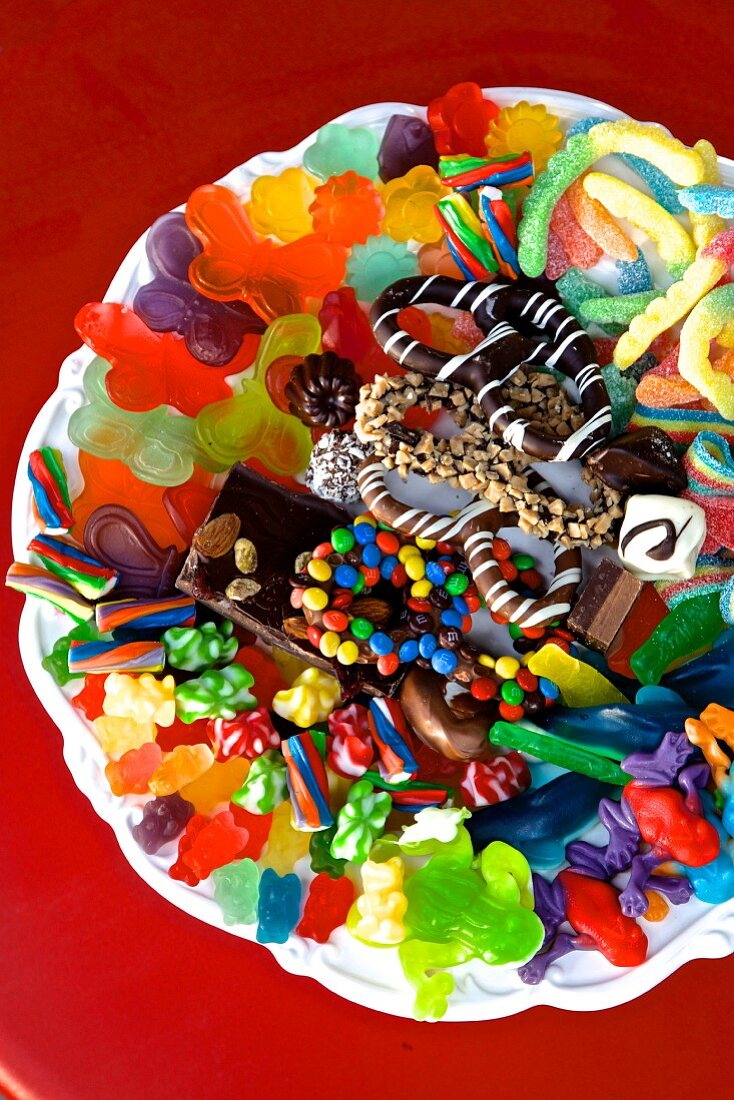 A colourful assortment of sweets on a white plate