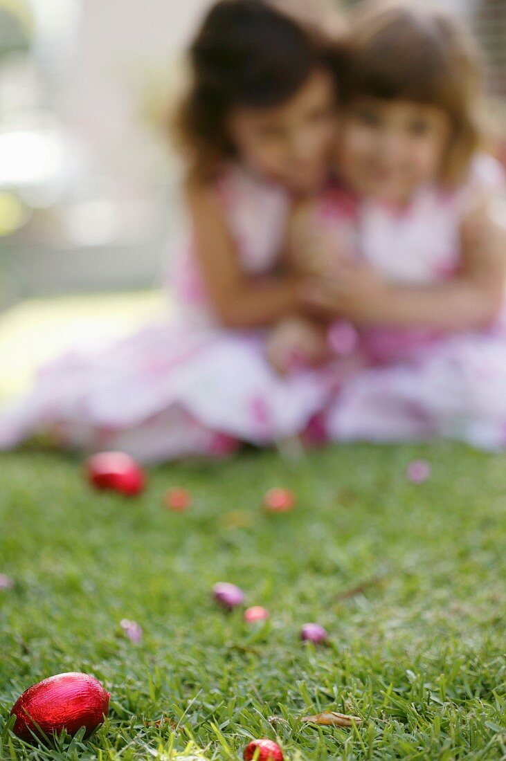 Girls looking for Easter eggs in the garden