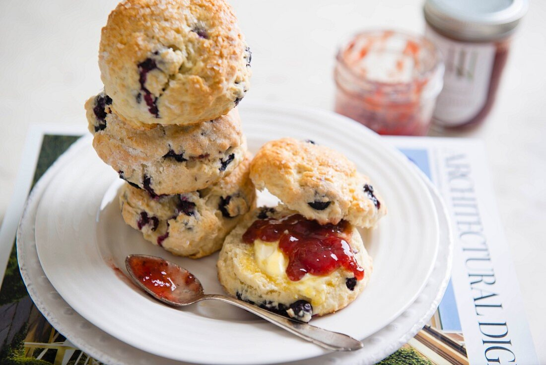 Freshly baked blueberry scones with butter and jam