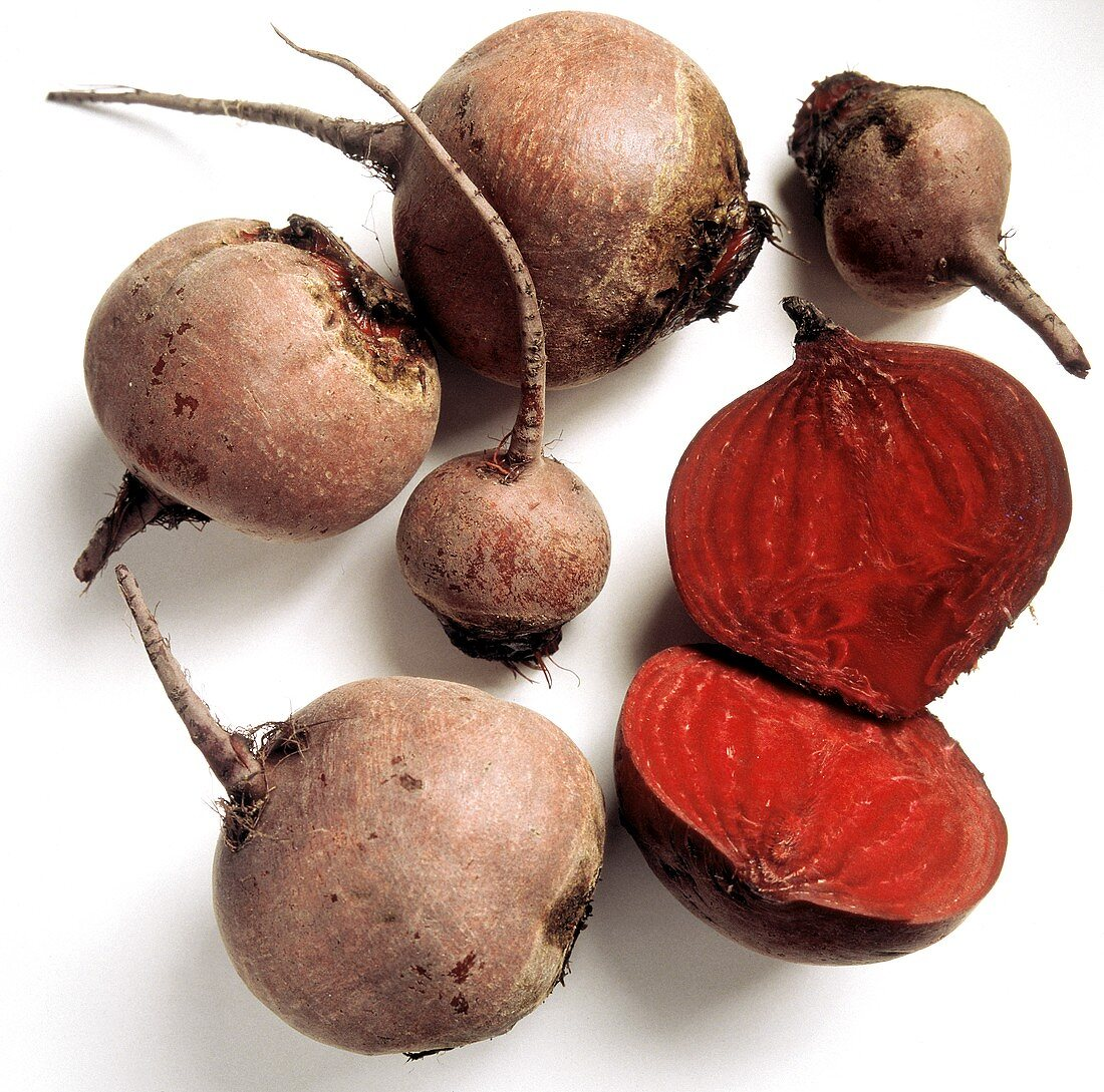 Several Red Beets; One Cut in Half