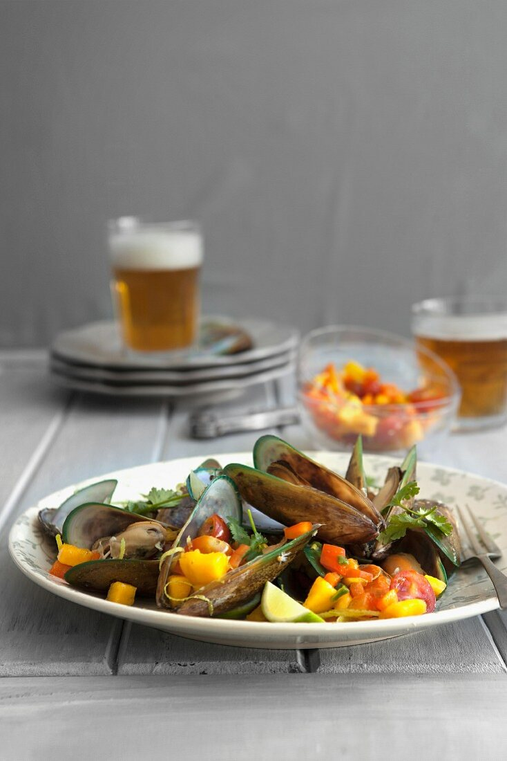 Mussels in a beer broth with mango salsa