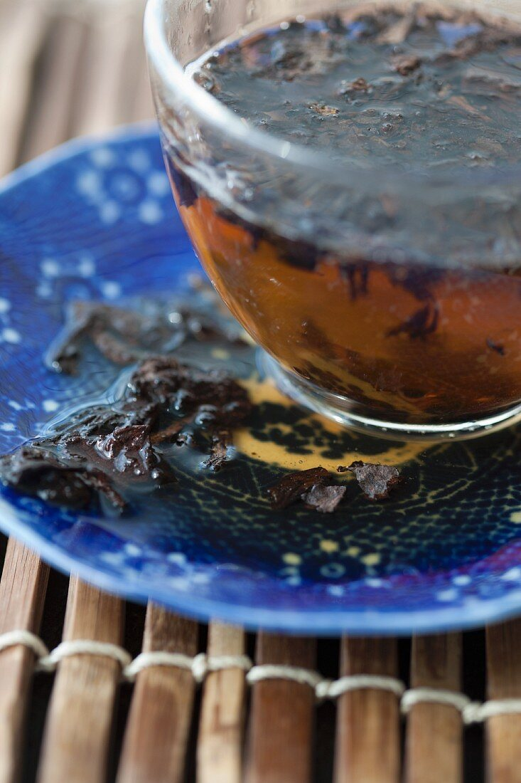 Brewed pu-ehr tea in a glass cup