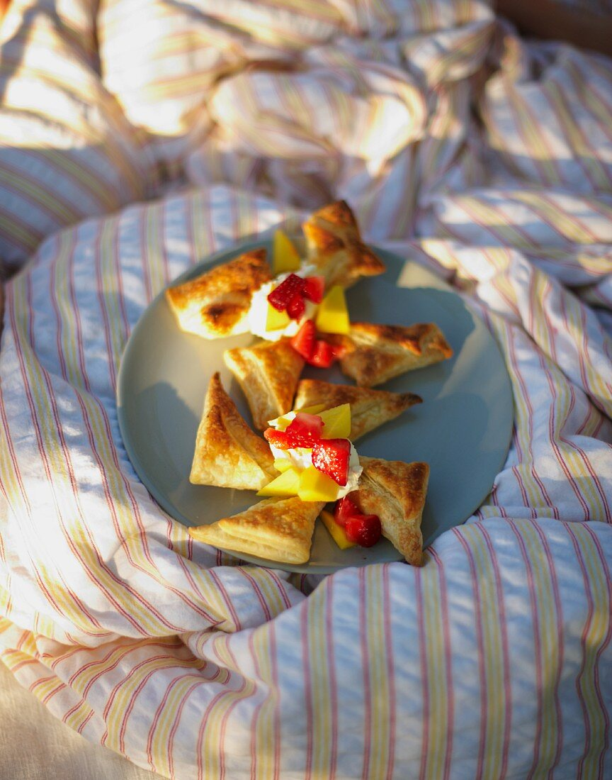 Windmills with fruit for breakfast in bed in a field