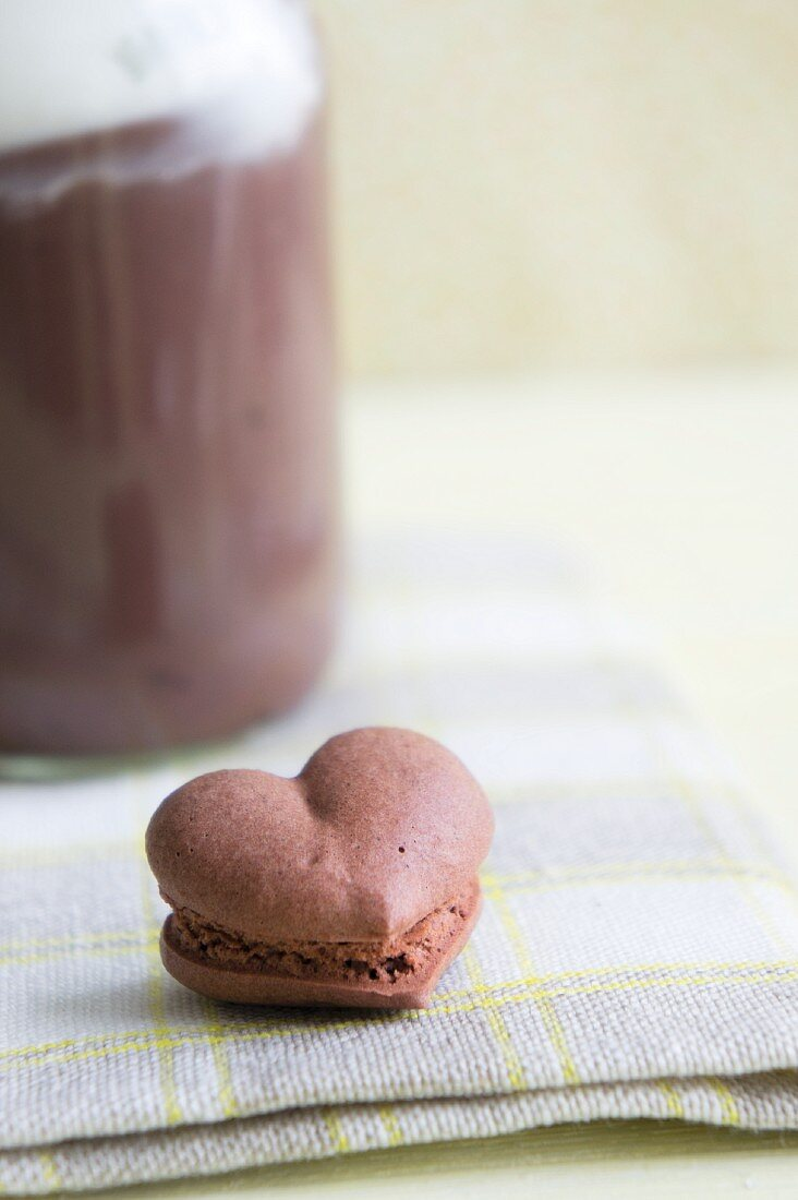 A heart-shaped chocolate macaroon