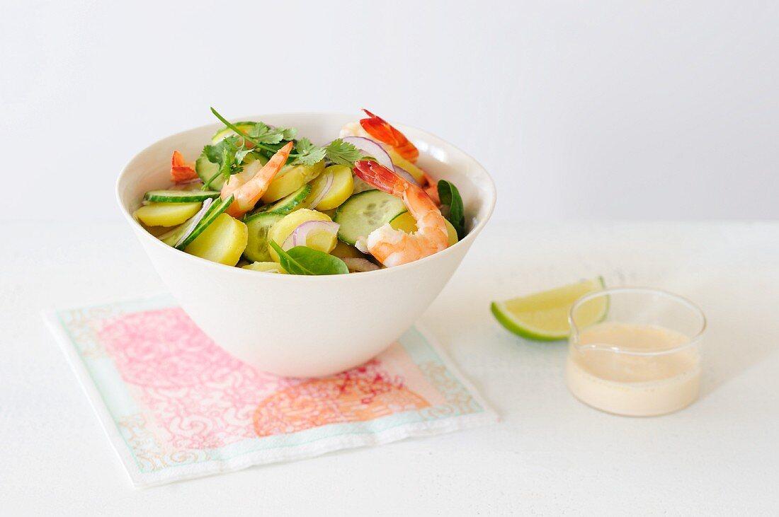 Potato salad with cucumber and prawns