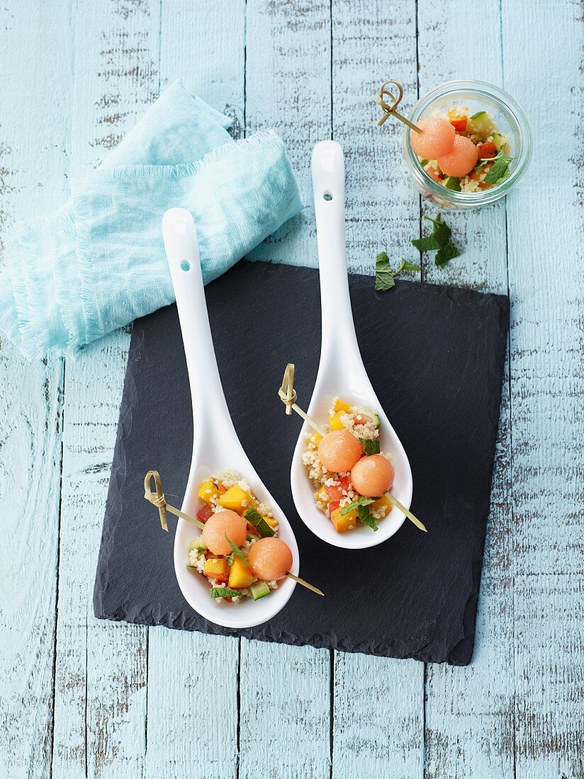 Couscous salad with pumpkin served with melon skewers