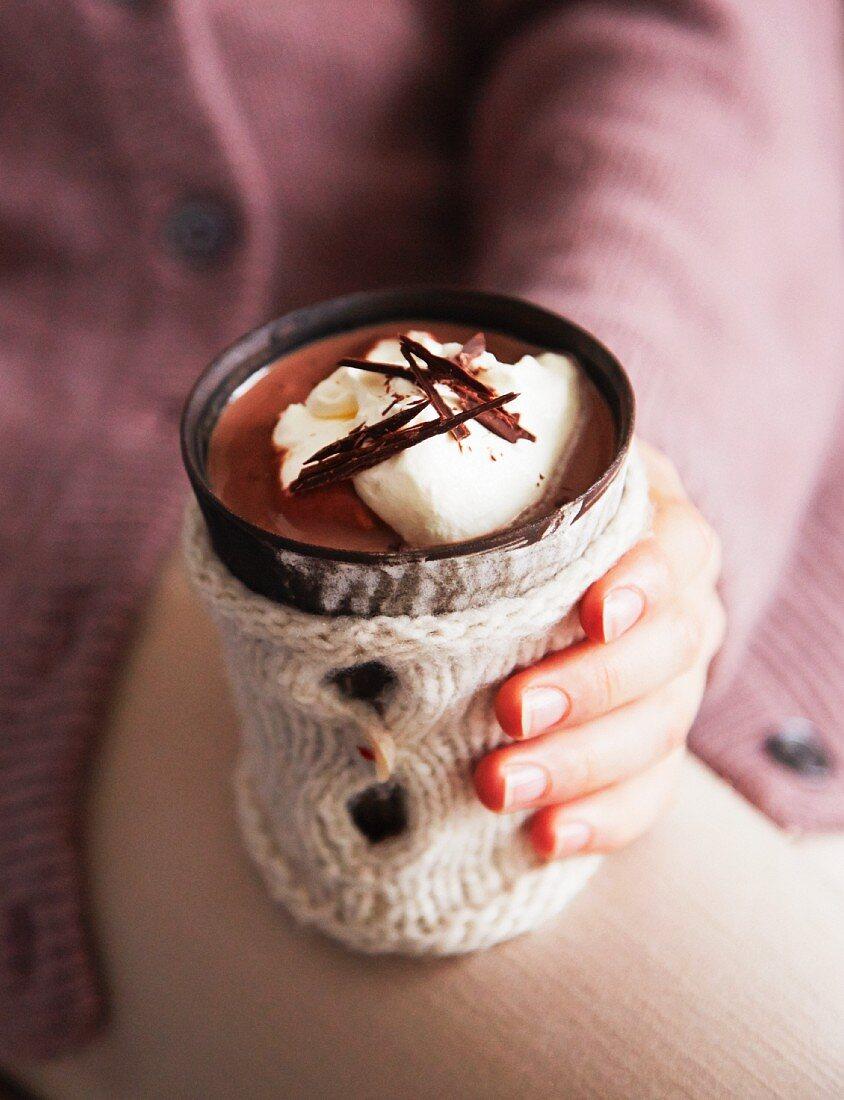 A woman holding a mug of hot chocolate
